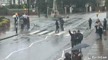 Guys waving, people crossing: yes, that's Abbey Road.